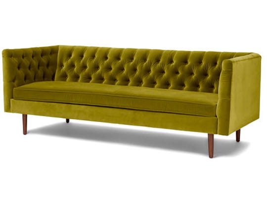 This undated photo provided by Article shows their tufted olive green velvet Chester sofa, which is a chic, sophisticated way to bring the trending color into a space.