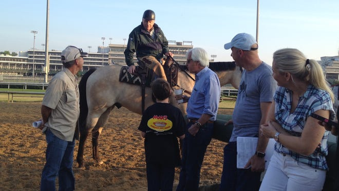 Trainer D. Wayne Lukas, on his pony, talked to colleague Bob Baffert and his family at Churchill Downs.