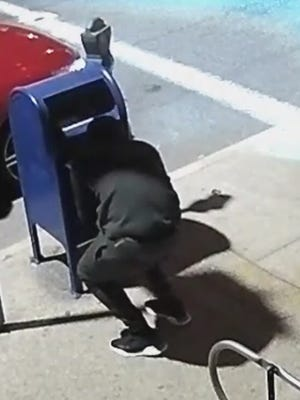 A suspect police are seeking in the theft of mail from mailboxes in the area of Yonkers Avenue in Yonkers on May 8, 2018.  The suspect is seen in a surveillance image released by police.