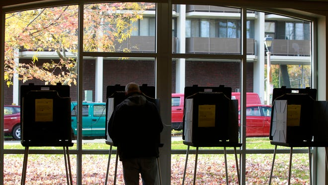 A resident of Shorewood votes at the Shorewood Village Center.