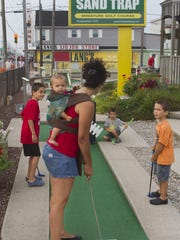 Mini-golf can be a family affair.