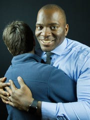Jamar Cotton, a deputy with the Doña Ana Sheriff's Department, will be attempting to break a Guinness world record by hugging 110 people in one minute during halftime at an Aggie Basketball game at the Pan Am Center later this month. Thursday Feb. 8, 2018.
