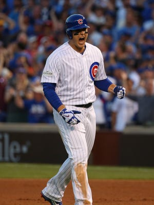 Anthony Rizzo celebrates after his go-ahead RBI-single against in the eighth inning.