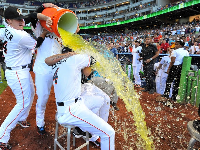 Miami Marlins pitchers Tom Koehler and Jose Fernandez dump Gatorade on Henderson Alvarez and coach Joey Espada after Alvarez threw a no-hitter against the Detroit Tigers.