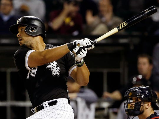 Chicago White Sox's Jose Abreu hits a solo home run during the first inning of a baseball game against the Cleveland Indians, Thursday, Sept. 7, 2017, in Chicago. (AP Photo/Nam Y. Huh)