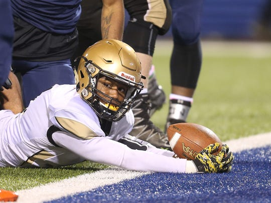 Athena's Kenny Speed slashes into the end zone for a touchdown against Bennett.