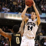 Butler guard Kellen Dunham shoots a three-point basket against Purdue during the second half, Saturday, December 14, 2013, at Bankers Life Fieldhouse.