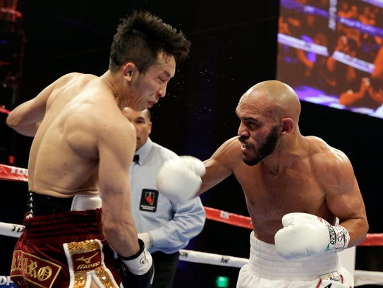 Ray Beltran, right, sends Takahiro Ao to the mat in