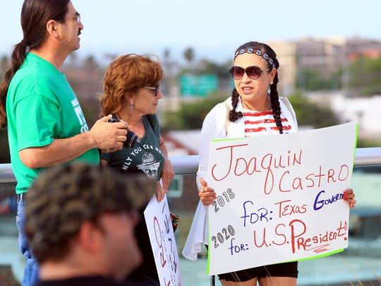 Mary Jane Olivarez (left) holds a sign as U.S. Rep. Joaquin Castro talks about a possible run against U.S. Sen. Ted Cruz during a meet-and-greet Monday, April 17, 2017, at the Corpus Christi Regional Transportation Authority in Corpus Christi.