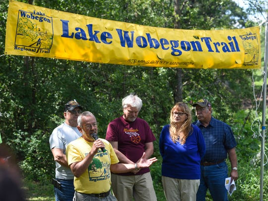 Chuck Wocken, former Stearns County parks director, speaks during a groundbreaking ceremony for the Lake Wobegon Trail extension Tuesday, Aug. 22, at River's Edge Park in Waite Park.