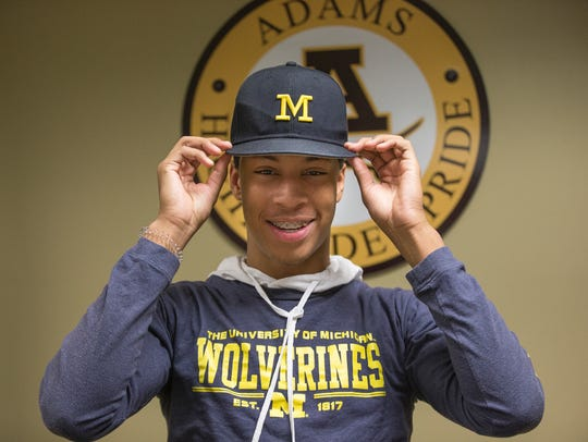 Michigan football signee Vincent Gray poses for a photo