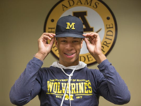 Michigan football signee Vincent Gray poses for a photo at Rochester Adams high school Wednesday, Feb. 7, 2018.
