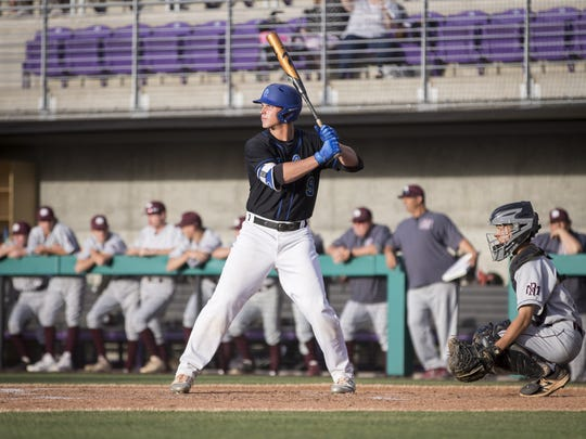 Nolan Gorman (9) of the Sandra Day O'Connor Eagles bats against the Mountain Ridge Mountain Lions at Brazell Field at Grand Canyon University on Thursday, April 19, 2018 in Phoenix, Arizona.
