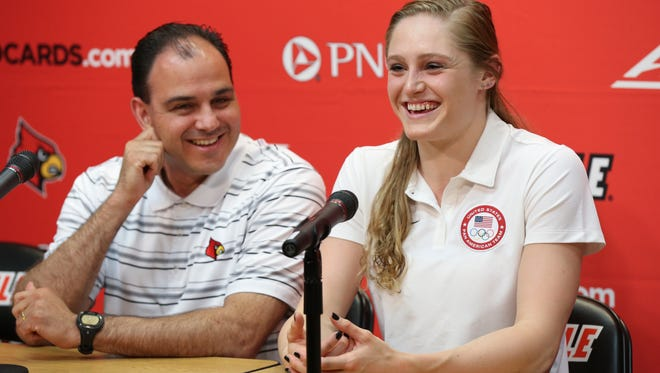 U of L Olympic swimmer Kelsi Worrell, right, and her coach Arthur Albiero laugh during a light moment as they speak to the media about the upcoming Olympic Games in Rio.July 7, 2016