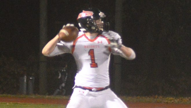 Hasbrouck Heights quarterback James Klenk throwing the ball against New Milford in a state playoff game.