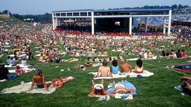 """A large part of the 7,000 to 8,000 music- and sun-lovers are dealing with high temperatures in the mid-90s on the then brand new Starwood Amphitheater's lawn for the """"One for the Sun"""" concert June 21, 1986."""