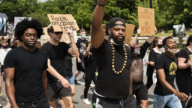 Protesters march from Doyle Field to City Hall in support of the Black Lives Matter movement on Friday in Leominster.