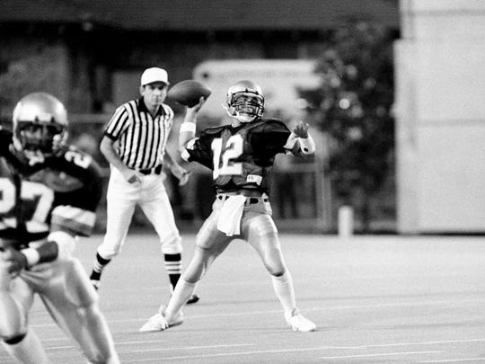 With running back Carl Woods (27) heading one way, Vanderbilt quarterback Kurt Page sets to pass the other way during their season opener against Kansas State Sept. 8, 1984 at Dudley Field. The Commodores won the game 26-14.