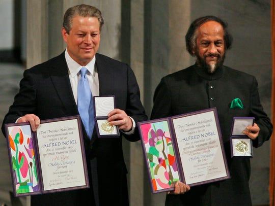 Nobel Peace Prize winners Al Gore, left, and Rajendra
