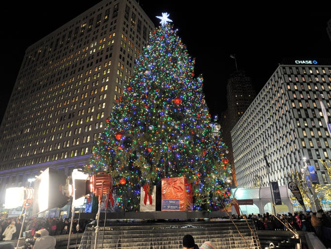 The 60-foot Norway spruce is aglow on Friday, Nov.
