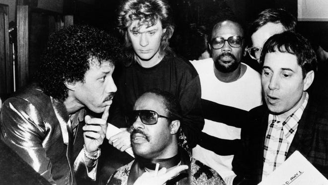 "Lionel Richie, clockwise from left, Daryl Hall, Quincy Jones, Paul Simon and Stevie Wonder record ""We Are The World"" by USA for Africa in 1985. Richie wrote the charity anthem with Michael Jackson."