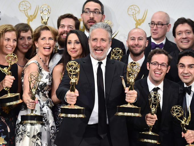Jon Stewart and the cast and crew, winners of the award