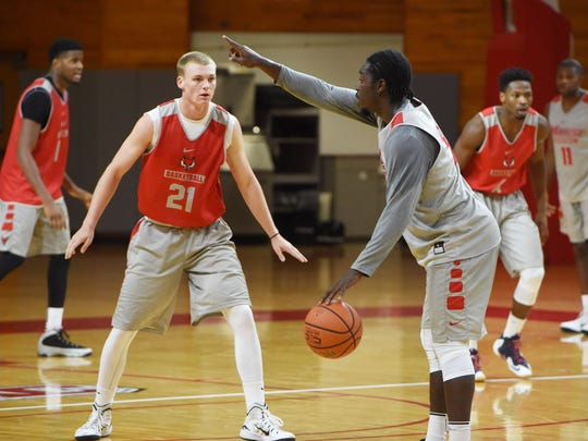 Marist College's Kyle Daugherty, left, and Khallid Hart, right, scrimmage on Monday.