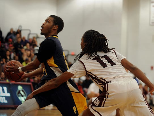 Pocomoke's Tyrone Matthews drives to the rim on Tuesday,