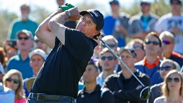 Phil Mickelson tees off on the 18th hole during the third round of the Waste Management Phoenix Open golf tournament at TPC Scottsdale.