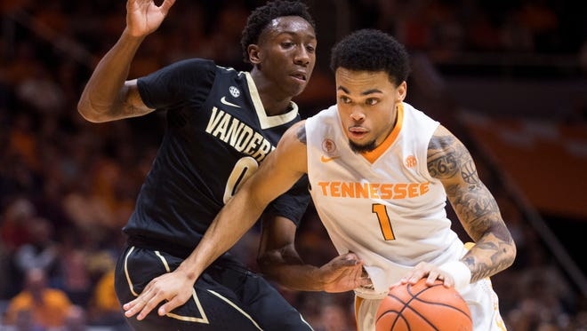 Tennessee guard Lamonte Turner (1) drives past Vanderbilt guard Saben Lee (0) during Tennessee's home basketball game against Vanderbilt at Thompson-Boling Arena on Tuesday, January 23, 2018.
