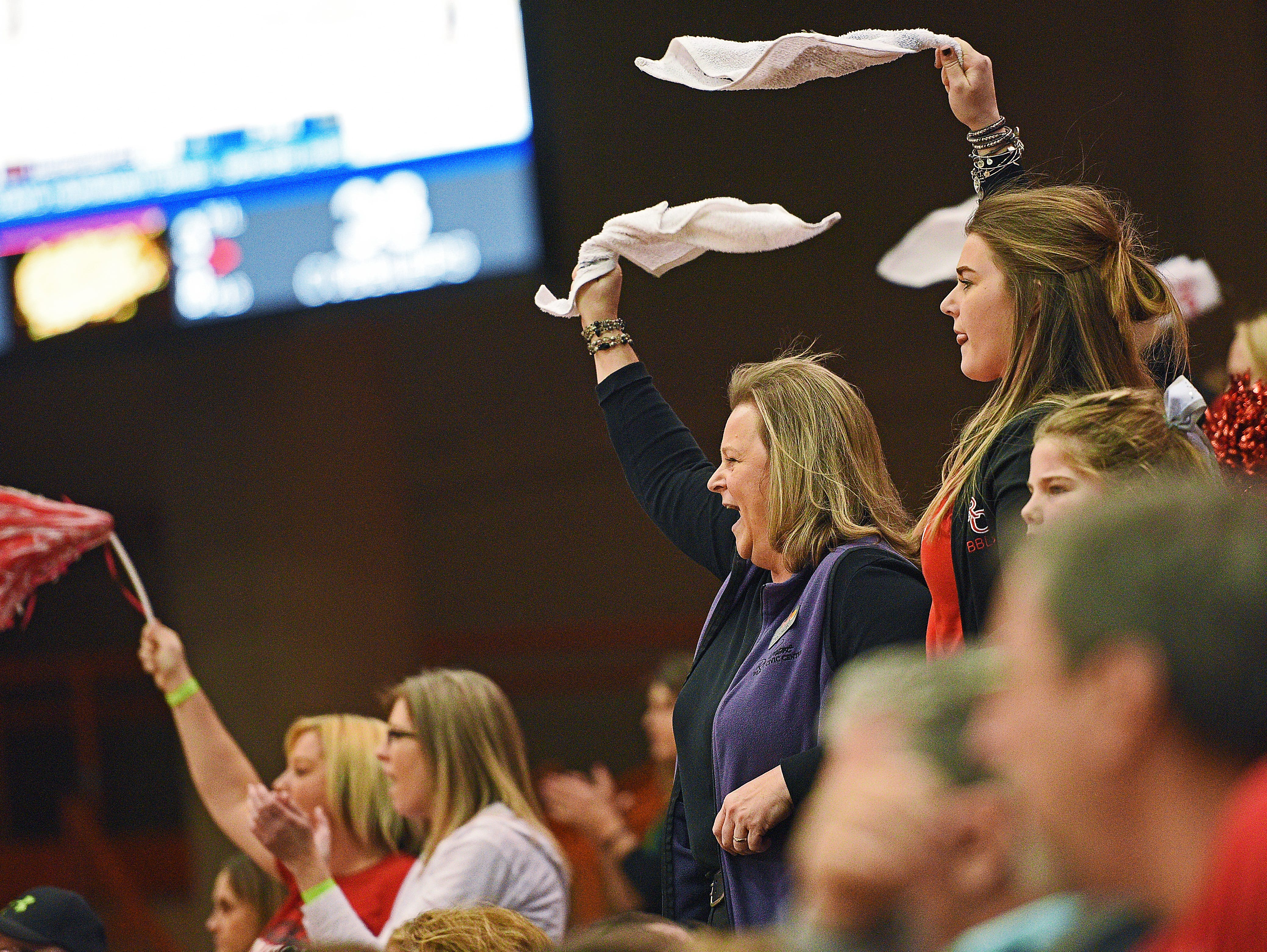 Rapid City Central fans cheer on their team during a 2017 SDHSAA Class AA State Girls Basketball semifinal game against Harrisburg Friday, March 17, 2017, at Rushmore Plaza Civic Center in Rapid City. Harrisburg beat Rapid City Central 49-44, and will play in Saturday's final.