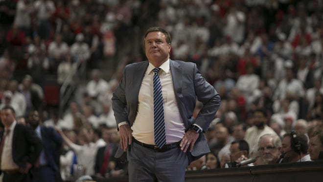 Kansas basketball head coach Bill Self checks the scoreboard during a game against on Texas Tech on March 7. Self is considering legal action against the NCAA.
