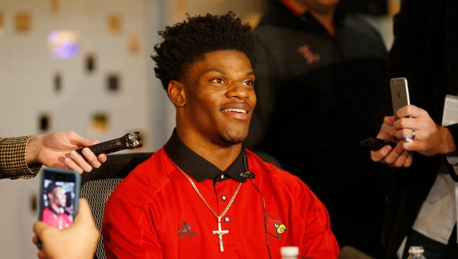 Louisville's Lamar Jackson was all smiles as he talked about being in New York City and the favorite for the Heisman Trophy. Dec. 9, 2016.