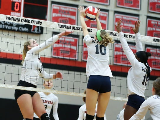 West York's Kate Tate goes for the block in the Bulldogs'