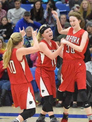 Norfork's Macy Dillard (from left), Kinley Stowers and Marleigh Dodson celebrate after Dodson was fouled while making a 3-pointer during the Lady Panthers' 53-42 victory over Mountain Home on Thursday night.