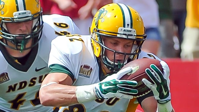 North Dakota State wide receiver Zach Vraa (82) stretches to reach the end zone in the Bison's win Saturday at Iowa State.