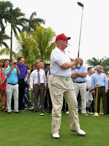 Donald Trump attends the opening of Red Tiger Golf