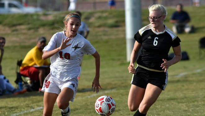 Tia Gladem, left, and the Centennial Hawks host Mayfield in the first round of the Class 6A state tournament Friday night at the Field of Dreams Soccer Complex.