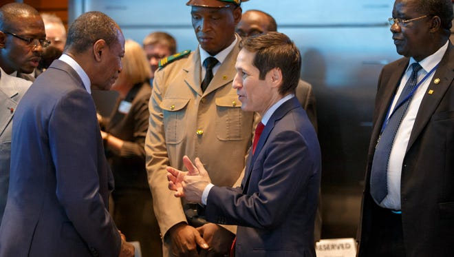"""In this Oct. 9, 2014, photo, Centers for Disease Control and Prevention Director Dr. Tom Frieden, center, speaks with Guinean President Alpha Conde, left, as the heads of the United Nations, International Monetary Fund and World Bank discuss the Ebola outbreak and what help is needed by the West African nations that are stricken with the outbreak at the World Bank in Washington. Last May, as Ebola crept across West Africa, America's top infectious disease expert told a group of Harvard students in a commencement speech to always second-guess their assumptions because """"overconfidence can kill.""""Five months later in a hearing room on Capitol Hill, Frieden was accused of not following his own advice _ repeatedly assuring the nation it was safe from an Ebola outbreak even as two U.S. nurses became infected and one was allowed to board a commercial airline, each following safety protocols Frieden helped put in place. (AP Photo/J. Scott Applewhite)"""