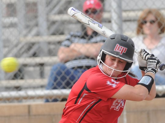 Lubbock Cooper's Kaitlyn Klemke braces before being hit in the head by a pitch in the second inning against Abilene Cooper. Lubbock Cooper won the District 4-5A game 13-2 in five innings Friday, March 23, 2018 at Cougar Diamond.