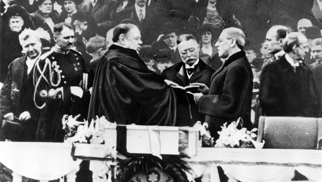 Woodrow Wilson takes the oath of office for his first term of the Presidency on the East Portico at the U.S. Capitol in Washington, D.C., on March 4, 1913.  Chief Justice is Edward D. White.  Liberals today tend to either glide over the undeniable racism of Progressive President Woodrow Wilson or else treat it as an anomaly of some sort. (AP Photo)