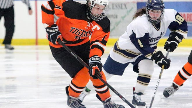 Middlebury captain Monroe Cromis takes control of the puck during the Tigers 3-1 loss at Essex on Saturday.