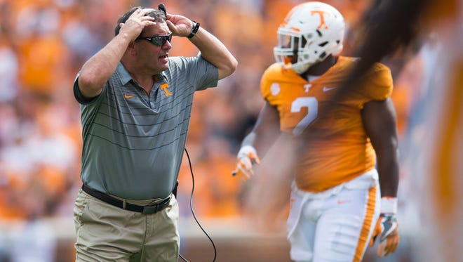 Associate Head Coach Brady Hoke speaks to a player during a Tennessee vs. South Carolina game at Neyland Stadium in Knoxville, Tenn. Saturday, Oct. 14, 2017.