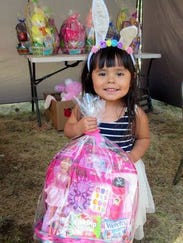 Thi little girl won an Easter basket of goodies almost