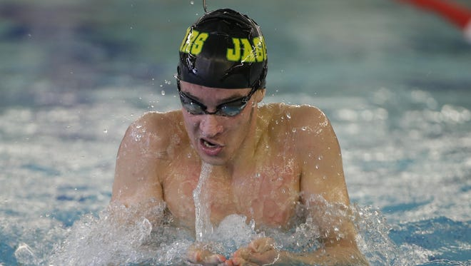 Ashwaubenon junior Max White, shown at the FRCC meet on  Feb. 6, won two individual sectional titles and was a part of two winning relays last Saturday at the WIAA Division 2 Stevens Point sectional.