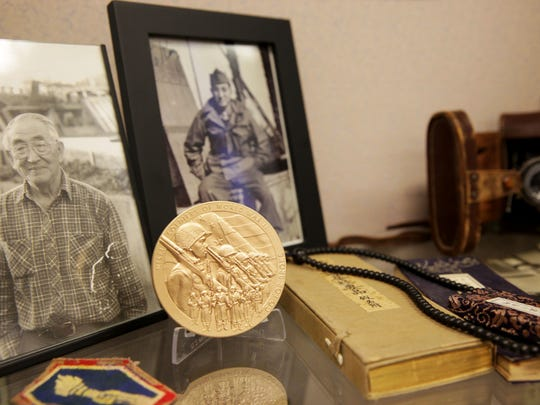 photos of Harry Takeshi Morioka are shown along with his personal belongings and replica of the Congressional Gold Medal, sit inside the Deschutes Historical Museum in Bend.