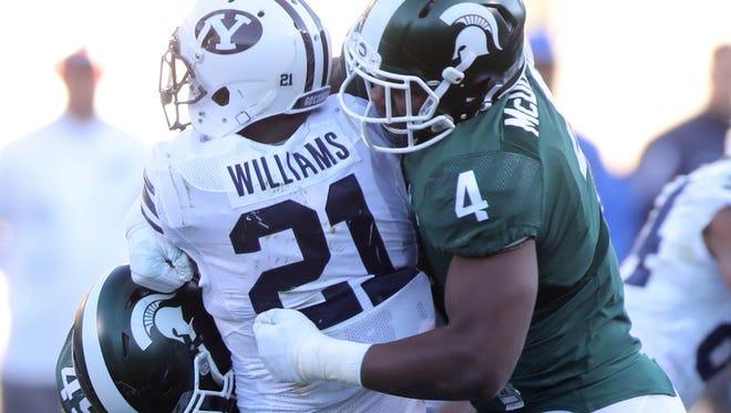 Michigan State Spartans Malik McDowell tackles BYU Cougars Jamaal Williams.