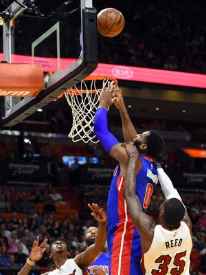 Pistons center Andre Drummond (0) is fouled by Heat forward Willie Reed (35) during the first half Sunday in Miami.