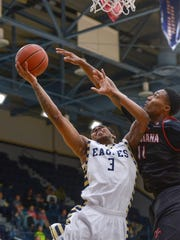 Georgia Southern's Ike Smith, left, earns a trip to the foul line while drawing a foul on Louisiana's Jerekius Davis during the second half at Hanner Fieldhouse Monday.
