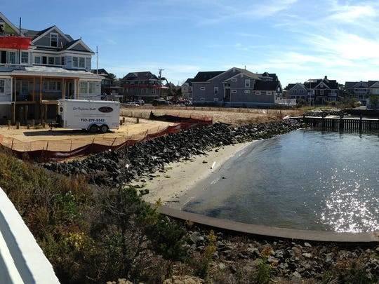 New homes are being built Wednesday, October 21, 2015, at the base of the Mantoloking Bridge in Mantolking as the third anniversary of Superstorm Sandy's landfall approaches.